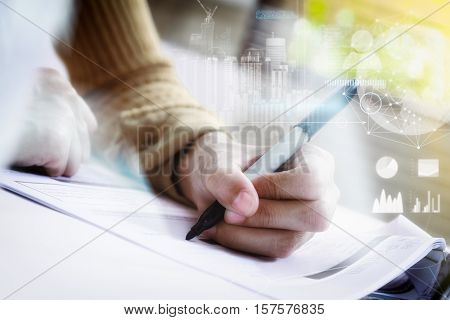 Double exposure of business woman prepare and writing for documents and graph business diagram film effect and business concept.