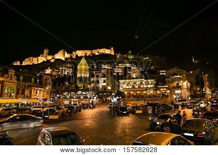 TBILISI, GEORGIA - OCT 01, 2016: People at night life in center of the Old Town Tbilisi on Oct 1, 2016. Tbiisi is the capital of Georgia and the largest city in Georgia