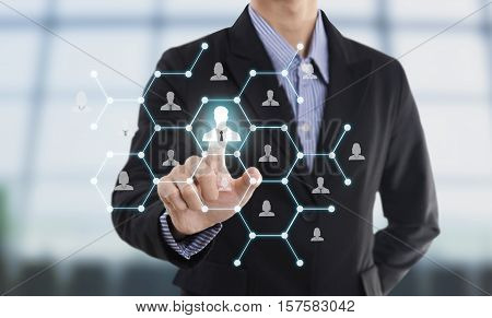 Businessman hand pressing icon on networking system concept employmentrecruitment hiring people social network communication.