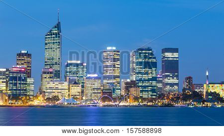 PERTH WESTERN AUSTRALIA - APRIL 7, 2016: Dusk falls over the city of Perth, the capital of Western Australia. The Swan River can be seen in the foreground.