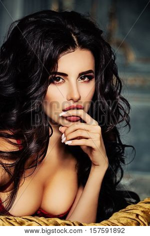 Portrait of Pretty Brunette Model. A Woman Touching her Hand her Lips