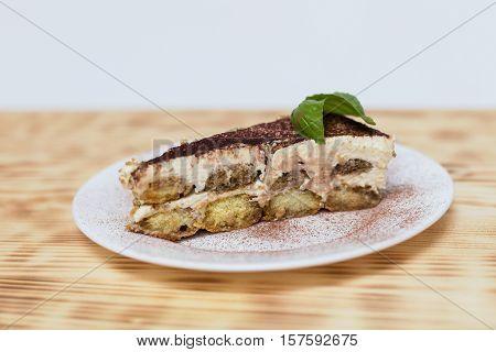 Tiramisu cake, homemade tiramisu dessert. Traditional Italian cuisine, Selective focus