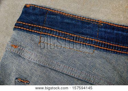 Blue jean seams-gray background