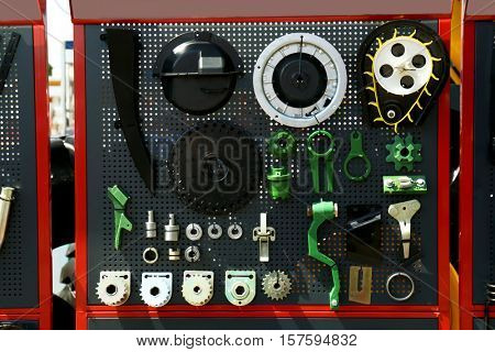 Stand with spare parts and tools for heavy equipment on agricultural exhibition
