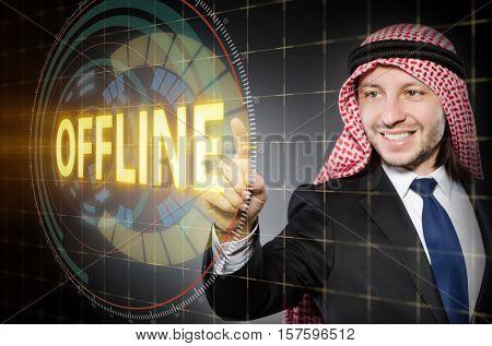 Arab man pressing offline button
