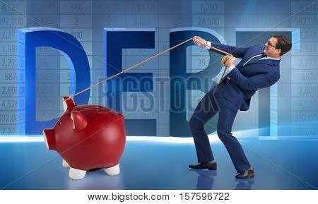 Businessman pulling piggybank with rope