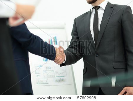 investor shakes hands with the speaker after the financial prese