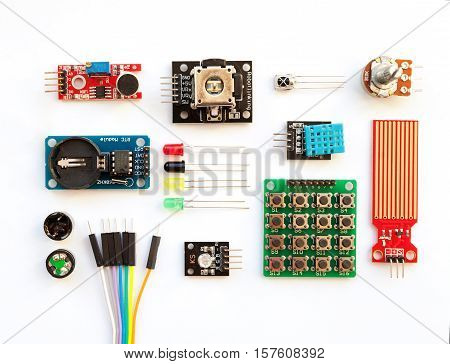 Electrical components kit for building digital devices isolated on white. Arduino robotics parts and elements. Electronics module set