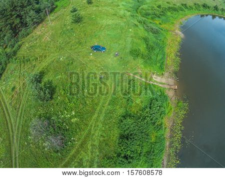 The view from the height of the river Mologa and the car next to the river bank. Shooting from height of the bird's flight. Maksatikhinsky District Tver Region.
