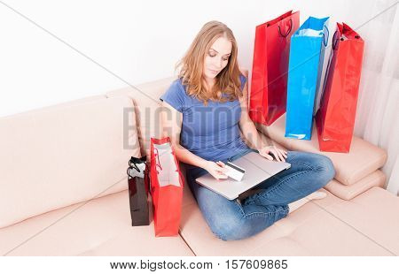 Home Woman Shopper Holding Credit Card And Laptop