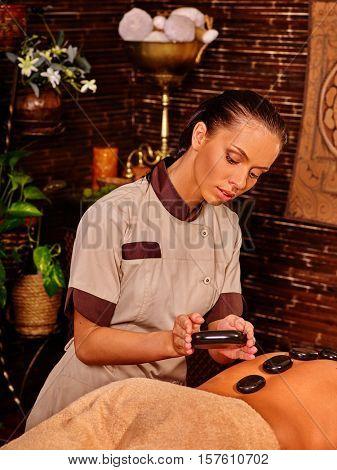 Man having massage . Man have stone massage. Stone massage therapy for man . Lastone massage therapy.