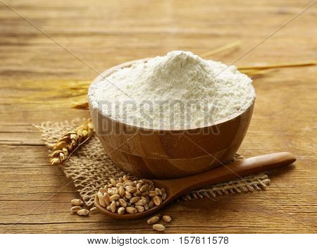Natural organic wheat flour. Grain on a wooden table
