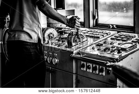 Сaptain's hands at a ferry steering wheel close-up. Black-white photo.