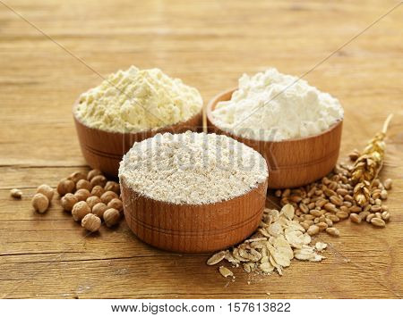 Oat, wheat and chick-pea flour in a wooden bowl