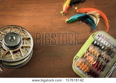 Fly fishing gear, which includes a reel and containers of flies with copy space