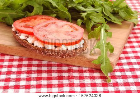 rey bread with cheese and fresh  tomato