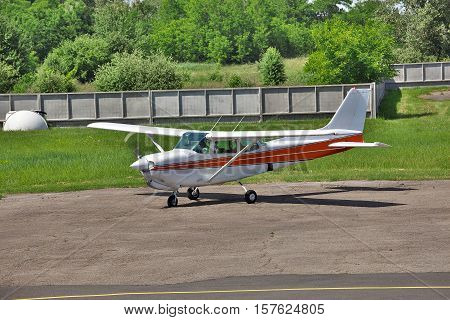 Light private plane is starting the engine on the parking of a private airfield for a leisure flight