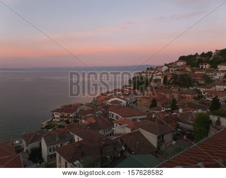Cityscape on the shores of Lake Ohrid in a breathtaking morning pink sky, Macedonia