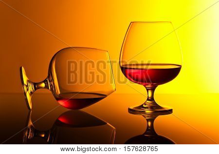 Snifters Of Brandy On Yellow Background