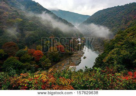 Mist rolling over the Katsura River in the Arashiyama area of Kyoto, Japan in autumn