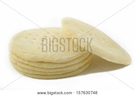 frozen ready-made pizza dough on white background