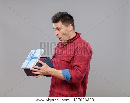 Happy Young Man With A Gift