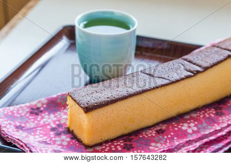 Castella - Traditional Japanese Sponge Cake And Hot Tea.