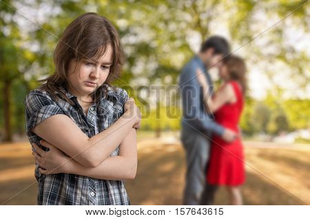 Young jealousy girl is seeing her boyfriend with other one girl.