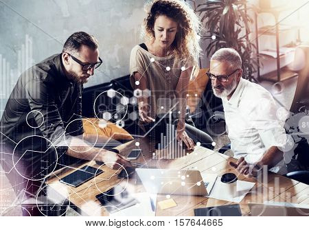 Concept of digital screen, virtual connection icon, diagram, graph interfaces.Young team of successful businessman making great discussion in modern coworking studio.Business people brainstorming process