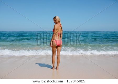 Attractive Woman In Bikini On The Beach