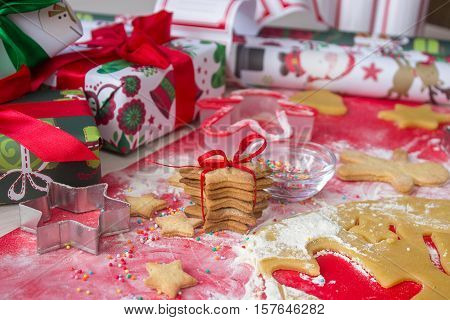 christmas presents and paper with homemade gingerbread cookies. Christmas bustle concept