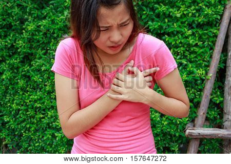Sporty woman having heart attack at park- Angina Pectoris Myocardial Infarction