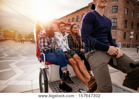 Teenagers Riding On Tricycle And Having Fun