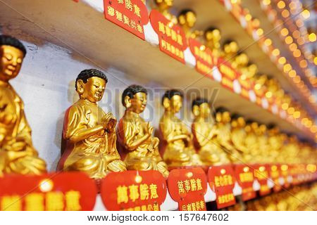 Side View On Different Small Golden Buddha Statues In The Interior Of The Ten Thousand Buddhas Monas