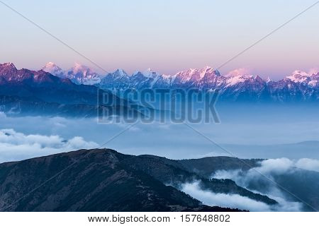 Stunning Landscape With Amazing Clouds Floating Between Mountains On The Sunrise. Himalayas Stunning