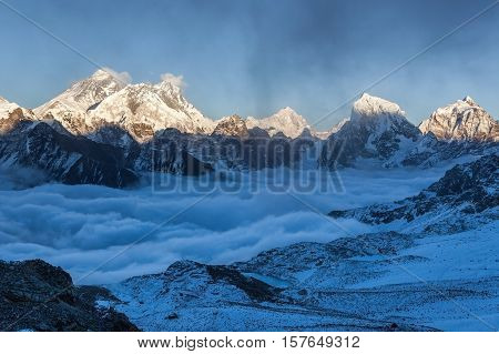 Everest Panoramic View From Renjo La Pass. Beautiful Mountain Valley Covered With Curly Clouds. Dram