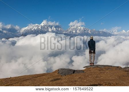 Solitude Landscape In High Himalayan Mountains In Nepal. Single Traveler Standing On The Edge Of The