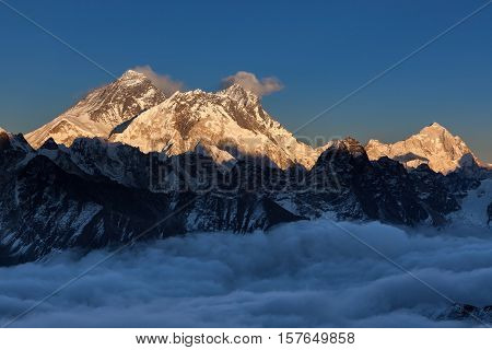Sunset Over Everest Summit, View From Renjo La Pass. Amazing View Of Mountain Valley Covered With Cu
