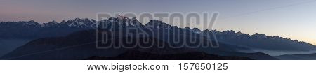 Panoramic Mountain Landscape With Amazing Mist Floating Between Hills On The Sunrise. Himalayas Pano