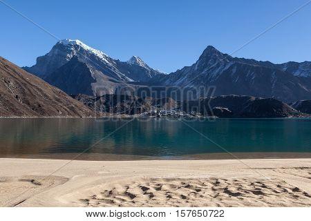 White Sand Beach Of Amazingly Beautiful Gokyo Lake. Transparent Turquoise Waters Of Mountain Lake Un