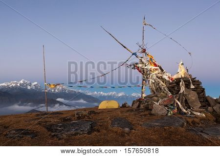 Mountain Camping Concept. Camping Tent On The Top Of The Pikey Peak Mountain Next To Buddhist Chorte