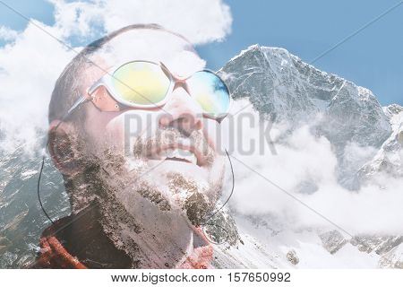 Portrait of a handsome mountaineer at mountain top