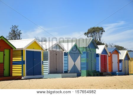 BRIGHTON-AUSTRALIA October 28, 2016: Colourful boxes in a row at Brighton beach in Victoria, Australia