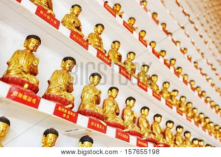 Golden Buddha Statues On The Wall Inside The Temple Of The Ten Thousand Buddhas Monastery