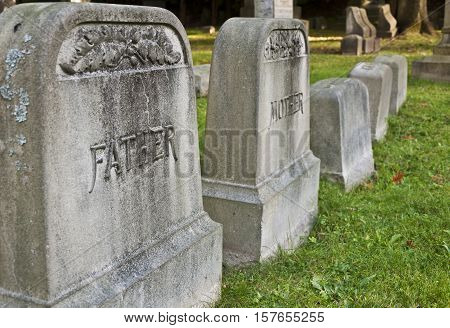 Father & mother tombstones in a cemetery
