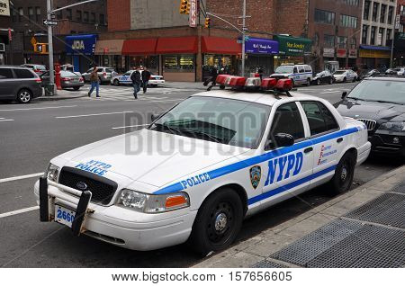 NEW YORK CITY - JAN 13, 2013: Ford Crown Victoria Police Car on 6th Avenue in Manhattan, New York City, USA