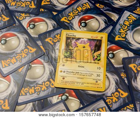 New York City, NY, USA - July 12, 2016: The Pikachu Pokemon card lying on top of a background of Pokemon trading cards. Illustrative Editorial