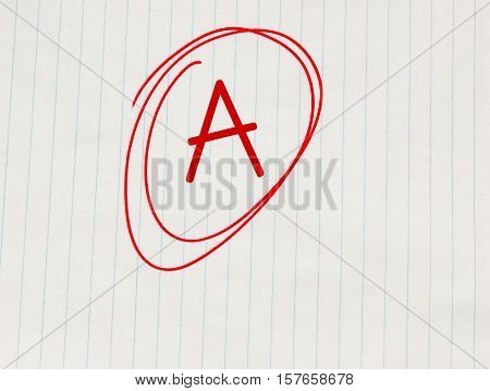 Grade A written in red on notebook paper