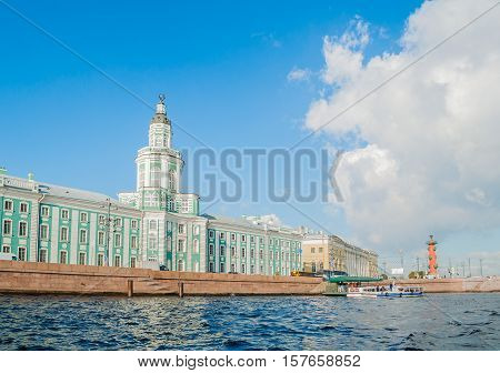 ST PETERSBURG RUSSIA - OCTOBER 3 2016. Architecture landscape of St Petersburg Russia - Kunstkamera Zoological museum and rostral column along the Neva river embankment in St Petersburg Russia