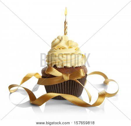 Birthday cupcake and ribbon on white background